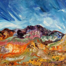 Acrylic painting of a mountain in the Andes with a celestial sky with rays of bright light and below a calm valley
